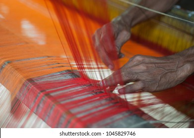 SIRAJANJ, BANGLADESH-APRIL 17, 2016: A worker weaves cloth at a traditional handloom factory in Sirajganj. Weavers of Pabna and Sirajganj districts the biggest handloom cloth producing zone in country