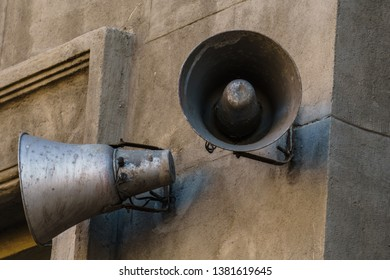 Siren loudspeakers on the wall of a house in the city