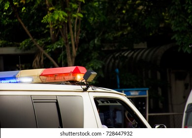 Siren on Ambulance van.Police car blue and red lights close up.