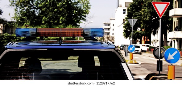 sirens of a police car patrolling the streets of a big city