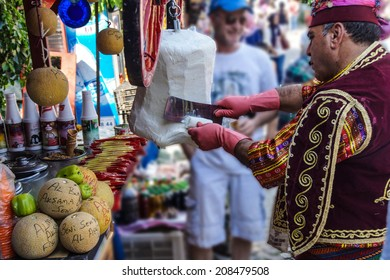 SIRINCE, TURKEY - MAY 25, 2014 - Costumed vendors sell traditional Turkish ice cream in  Ephesus, Turkey