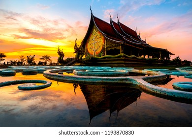 Sirindhorn Wararam Temple (Phu Prao Temple) in sunset and night, Ubon Ratchathani, Thailand. ( Generality in Thailand ,and kind of art decorated in Buddhist church, temple pavilion ,temple hall.)
