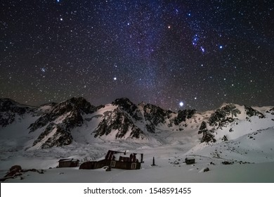 Sirius rising over Tien Shan mountains at cold winter night
