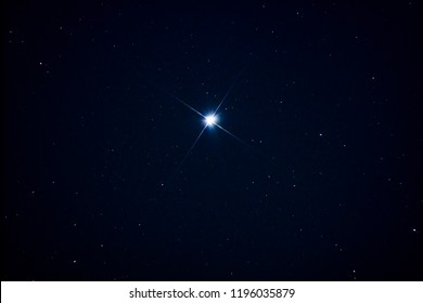 Sirius star over polluted sky