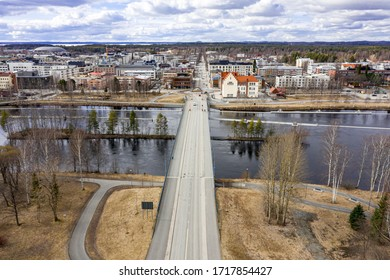 Sirkkala Bridge over the Pielisjoki river. Spring cityscape. Aerial view of Joensuu, Finland.