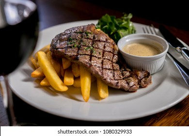 Sirloin Steak and Chips with a glass of Red Wine