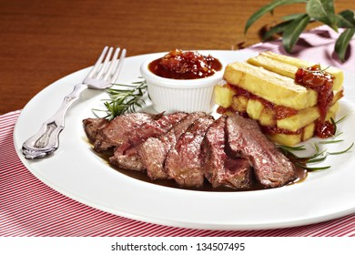sirloin steak with fried potatoes and tomato sauce