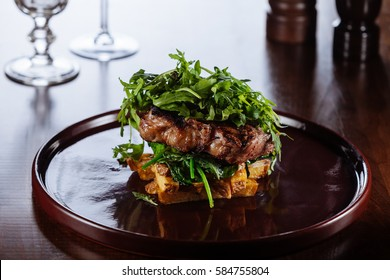 Sirloin steak with potato and rucola/Bife da Rainha/Traditional Portuguese cuisine