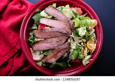 sirloin steak with summer salad, a ketogenic diet meal