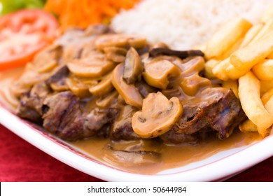 sirloin strip steak with french fries and rice
