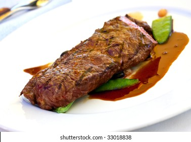 Sirloin strip Steak with green Beans ,vegetables and savory sauce