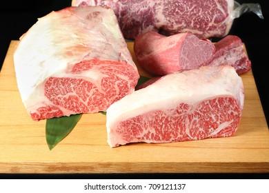 Sirloin and Tenderloin Wagyu Beef on wooden plate Teppanyaki Style