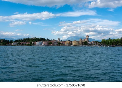 Sirmione (BS) / Italy - April 30, 2018: View of Sirmione from the ferry on Lake Garda.