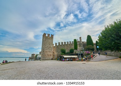 SIRMIONE, ITALY - 07 October 2018:Scaliger Castle in Sirmione,Lago di Garda in Italy,Old Castle in the Historical town Sirmione on peninsula in Garda lake, Lombardy