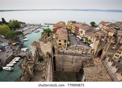 Sirmione Italy - Apr 2017: Viewing the scenic old town and Lake Garda from tower top of Scaliger Castle