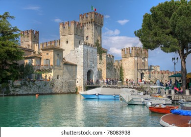 SIRMIONE, ITALY - APRIL 27: Scaliger Castle stands at the entrance to Sirmione, on Lake Garda, Italy on April 27, 2011. The 13th century castle is an example of medieval port fortification.