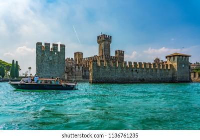 Sirmione, Italy - July 14, 2018: Motor boat on Garda lake at Sirmione, Italy.
