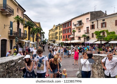 SIRMIONE, ITALY - JULY 31 2016: Tourists walking on colorful streets on 31 July 2016 in Sirmione, Italy.