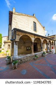 SIRMIONE, ITALY - July 31, 2018: Arcade entrance of the Chiesa di Santa Maria Maggiore or Della Neve, parish church of the small town and peninsula of Sirmione, Lombardy, northern Italy