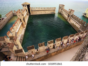 Sirmione, Italy - June 04, 2017.: Tourists visit in Sirmione. Castle and fortress in Sirmione, Italy