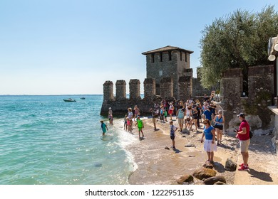 SIRMIONE, ITALY - JUNE 16, 2016: Garda lake, Public beach in Sirmione in a beautiful summer day, Italy on June 16, 2016
