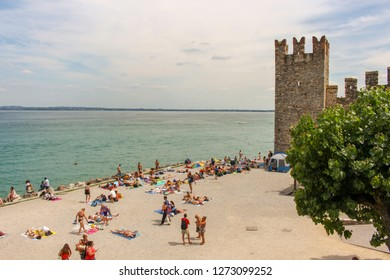 Sirmione / Italy - June 24, 2018: View of Scaliger Castle (13th century) from beach in Sirmione on Garda lake in Italy.