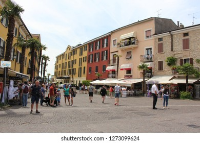 Sirmione / Italy - June 24, 2018: Picturesque colorful old houses on the streets of Sirmione town-summer resort on Garda Lake