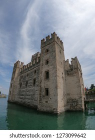 Sirmione / Italy - June 24, 2018: The Scaligero Castle is a fortress from the Scaliger era, access point to the historical center of Sirmione at Garda Lake, Italy.