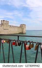 Sirmione / Italy - June 24, 2018: Love Padlock on a bridge in Sirmione at Garda Lake, Italy.