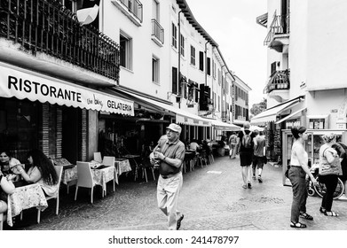 SIRMIONE, ITALY - JUNE 26, 2014: Shopping street in the Sirmione town, Italy. Sirmione became popular touristic destination on the Lake garda, the largest lake in Italy