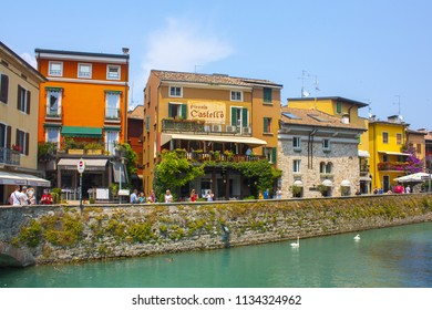 Sirmione, Italy - June 28, 2018: Picturesque street in Old Town of Sirmione, Italy