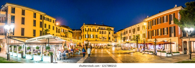 Sirmione, Italy - October 22: people in the famous old town with shops and restaurants on October 22, 218 in Sirmione, Italy
