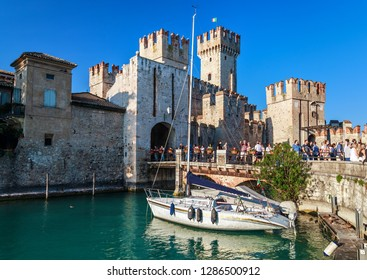 SIRMIONE, ITALY - SEPTEMBER 29, 2018: View of the medieval Rocca Scaligera castle in Sirmione town on Garda lake, Italy.