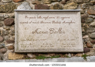 Sirmione, Lombardy / Italy - 03 07 2019: Close-up of the memorial plaque dedicated to the famous soprano Maria Callas (1927-1977) on the wall of her vacation villa on the shore of Lake Garda
