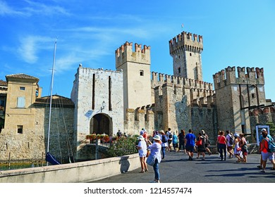 Sirmione,Lombardy,Italy-July 19 2018.The Scaligero Castle is a  rare example of medieval port fortification , access point to the historical center of Sirmione.