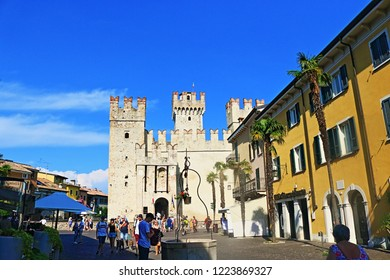 Sirmione,Lombardy,Italy-July 19 2018:A view of Piazza Castello-Castle square with Rocca Scaligera-unique 13th-century castle  in Sirmione summer resort town on Garda Lake