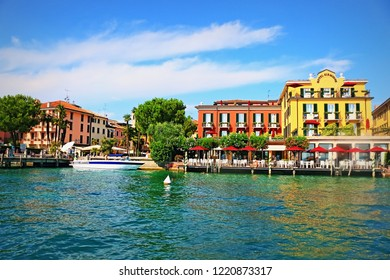 Sirmione,Lombardy/Italy-July 19 2018:Beautiful view of Sirmione resort town on the southern bank of Lake Garda, in northern Italy seen from tourist bout navigating in the lake