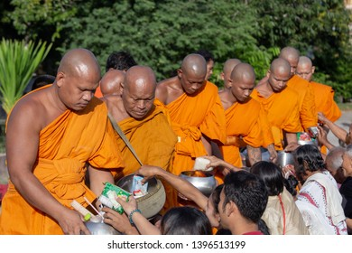 SISAKET ,THAI–CIRCA March 2019-Villagers give alms to the monks in temple in occasion Sart Day as same as Makha Bucha,Vesakha Bucha,Asarnha Bucha ,Buddhist Lent. For Deceased was held of March 2019