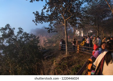 SISAKET, THAILAND - DEC24, 2017: Tourist enjoy and see the sunrise with fog at Pha Mor E-Dang in Khao Phra Wihan National Park,Thailand