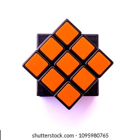 Sisaket, Thailand, MARCH 2, 2018. Top view of Rubik's cube with shadow on white background.