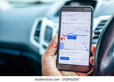 Sisaket, Thailand - March 3, 2021: Tourists use smartphones to guide their trips Sisaket to Bangkok with Google Maps.