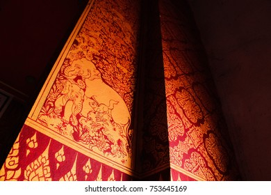 Sisaket, Thailand, October 22, 2016: The picture of elepants in the forest in golden and red toning on wall painting in buddhist temple