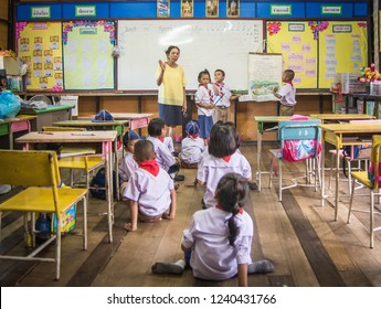 SISAKET THAILAND, SEPTEMBER 20,2018: Teacher and students at Ban samo School studying in the classroom with old white broad. Sisaket Province, Thailand Septemberl 20, 2018