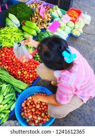 SISAKET, THAILAND – SEPTEMBER 24, 2018 Woman seller vegetable in Katthalak Market in Sisaket Thailand. Traveling in Sisaket Thailand. Blurred photo.