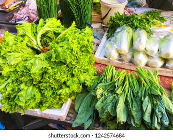 SISAKET, THAILAND – SEPTEMBER 24, 2018 Vegetable in Katthalak Market in Sisaket Thailand. Traveling in Sisaket Thailand. Blurred photo.