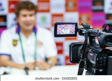 SISAKET THAILAND-FEBRUARY 18: Professional camcorder recording at a press conference after the match between Sisaket FC and BEC Tero at Sri Nakhon Lamduan Stadium on February 18,2015,Thailand