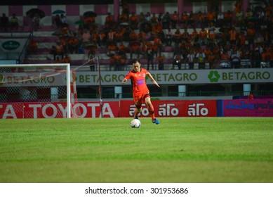 SISAKET THAILAND-JULY 25:  B.Khapfa (orange) of Sisaket FC. in action during  Thai Premier League between Sisaket FC and Nakhonratchasima FC at Sri Nakhon Lamduan Stadium on July 25,2015,Thailand