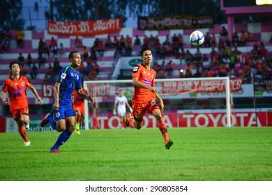 SISAKET THAILAND-JUNE 21: Kittipong Wongma (orange) of Sisaket FC. in action during  Thai Premier League between Sisaket FC and Navy FC at Sri Nakhon Lamduan Stadium on June 21,2015,Thailand