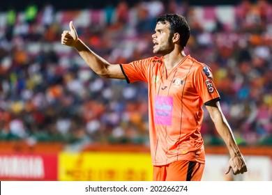 SISAKET THAILAND-JUNE 29: Victor Amaro of Sisaket FC. (orange) in action during Thai Premier League between Sisaket FC and Bangkok Utd at Sri Nakhon Lamduan Stadium on June 29,2014,Thailand