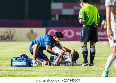 SISAKET THAILAND-OCTOBER 15: First aid team of Buriram Utd. (blue) in action during Thai Premier League between Sisaket FC and Buriram Utd at Sri Nakhon Lamduan Stadium on October 15,2014,Thailand